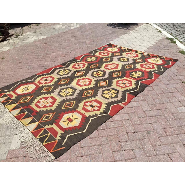 Beautiful, vintage, handwoven Kilim is approximately 60 years old. It is handmade of very fine quality, hand-spun wool in...
