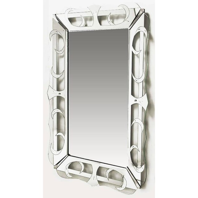 Very large art deco mirror framed in glass which has been wheel cut etched and silver patterned in crescents and open...