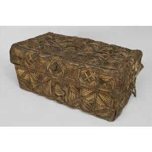 South American Colonial (Peruvian 19th Cent) cowhide and leather floor trunk (Bataca) with a geometric strap design
