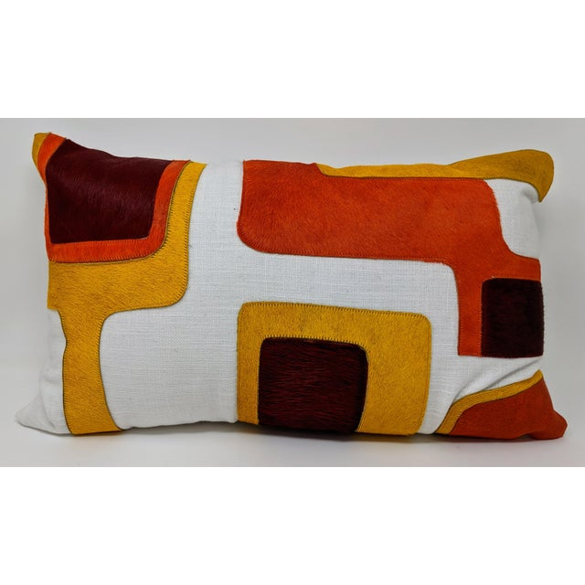 Available as a single accent or as a pair (sold separately), this linen and cowhide pillow will add a pop to any setting....
