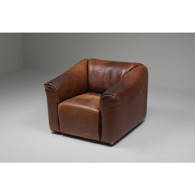 Brown leather armchair by Swiss manufacturer De Sede. Bullhide leather with retractable seating for an even more...