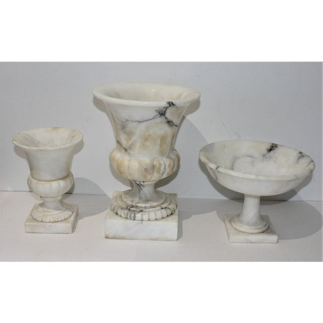 Lovely neoclassic revival trio of marble objects - large and small urn and matching compote -- a set of three from the...