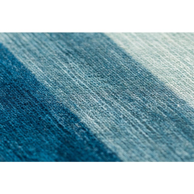 "Our ""Color Spectrum"" is woven with parachute-like quality silk dyed in our classic Botanical Ayurvedic dyes. This carpet..."