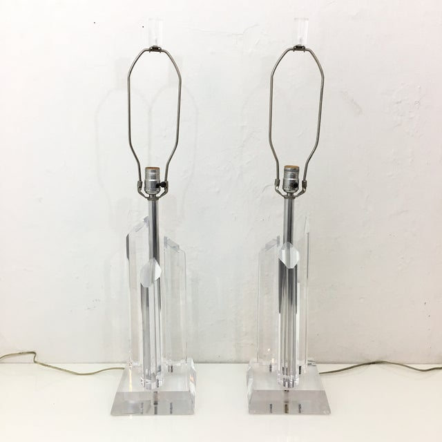 Being offered is a vintage matching pair of Karl Springer Style lucite lamps. These are a great size and make a stunning...