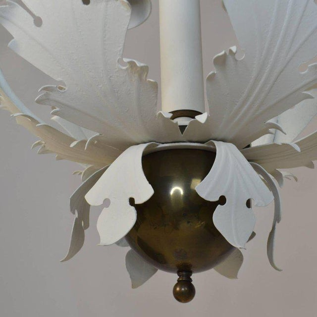 A 1980s, Glam chandelier by Hart Lighting, in the form of a central shaft and six scrolling leaf arms holding brass...