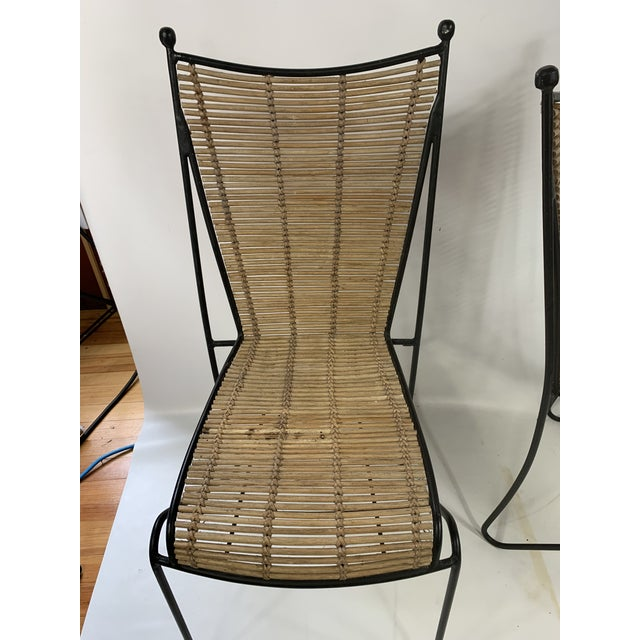 Great pair of heavy iron chairs made by Ficks & Reed