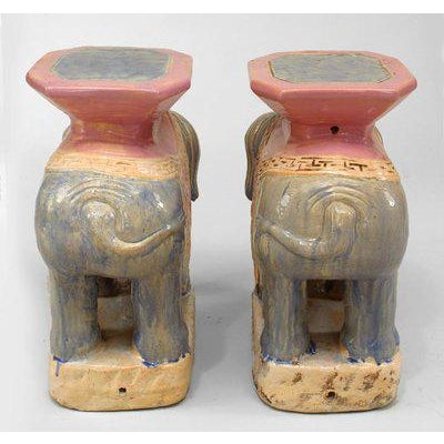 Pair of Asian Chinese style (20th Cent) purple and pink porcelain elephant garden seats