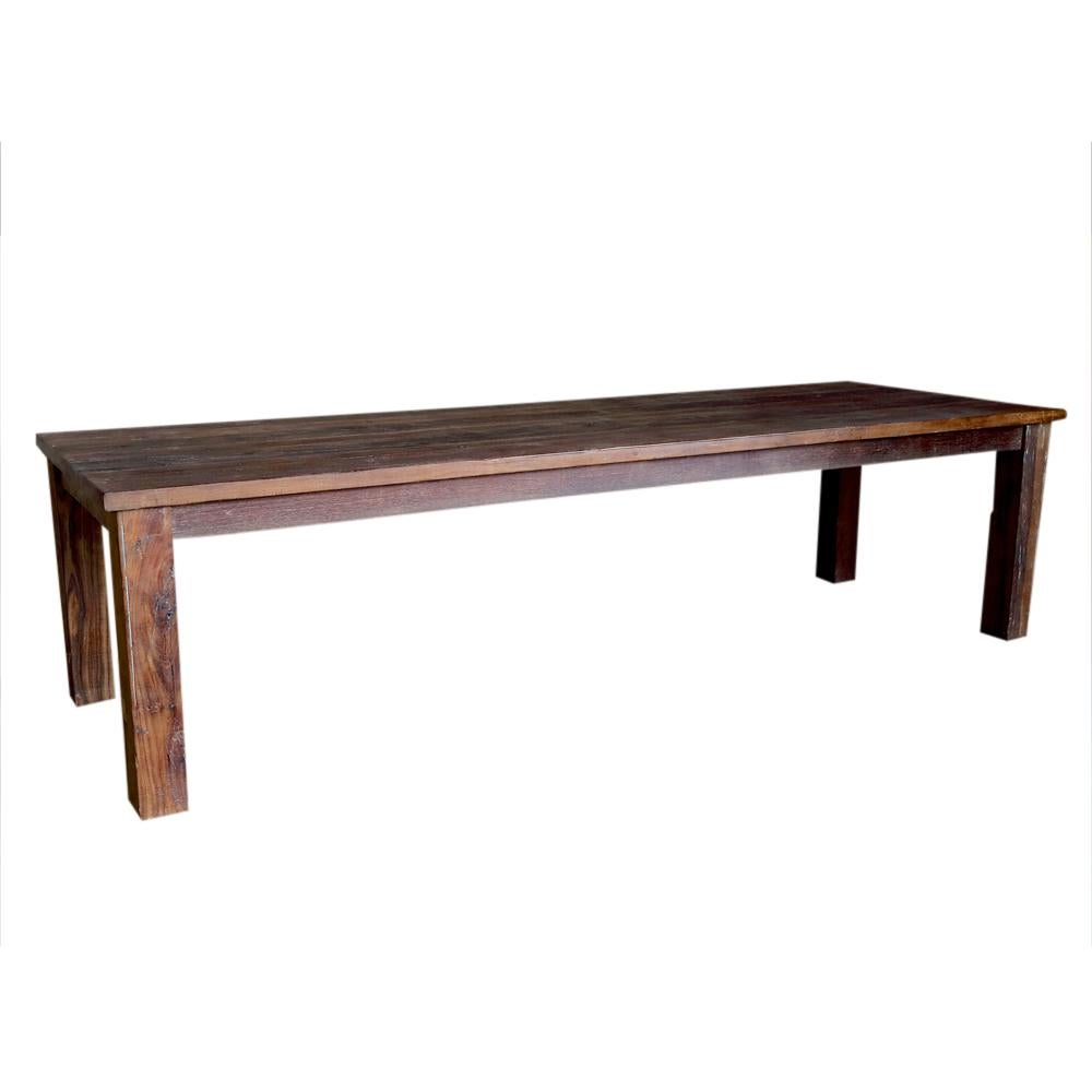 A Very Long Rustic Dining Table Constructed From Reclaimed Teak Wood, It  Stands On Squared