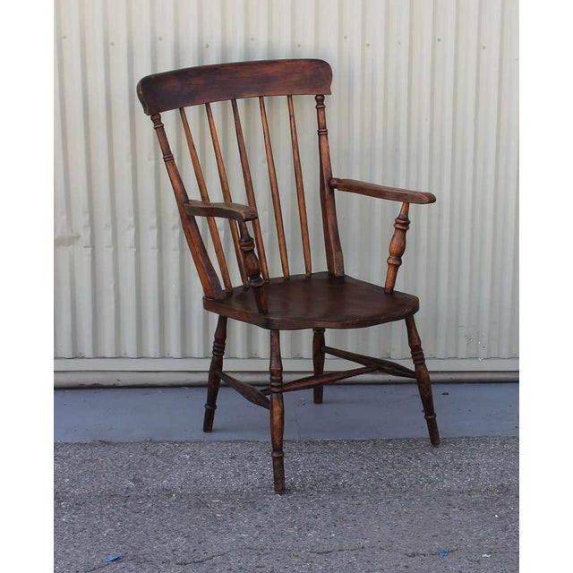 This amazing 19thc walnut tall back English arm chair is in wonderful original surface. This five spindle chair is very...