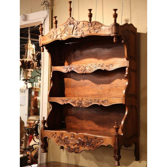 """This beautifully carved, antique fruitwood """"estanier"""" was crafted in Southern France, circa 1880. An estanier was..."""