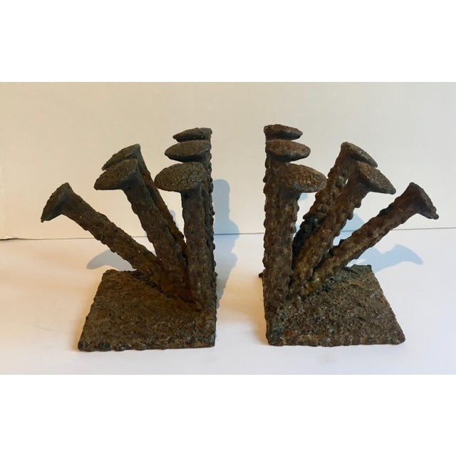 A handsome example of Brutalist Style in a pair of very heavy bookends... perfectly suited for any room, desk or shelf and...