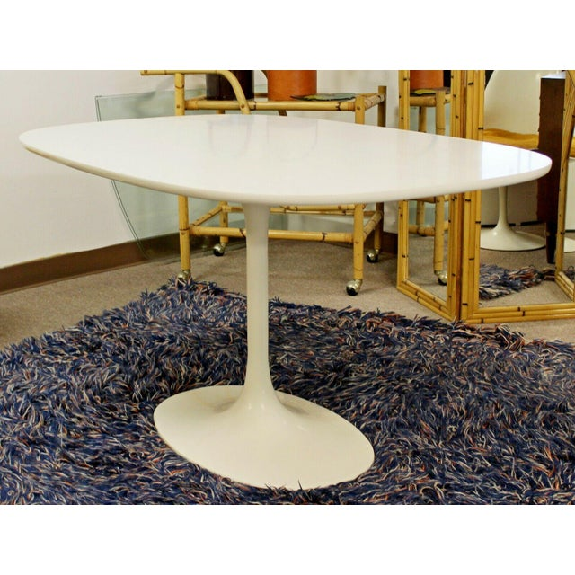 For your consideration is an Eero Saarinen style Tulip dining table, by Burke, circa the 1960s. In excellent vintage...