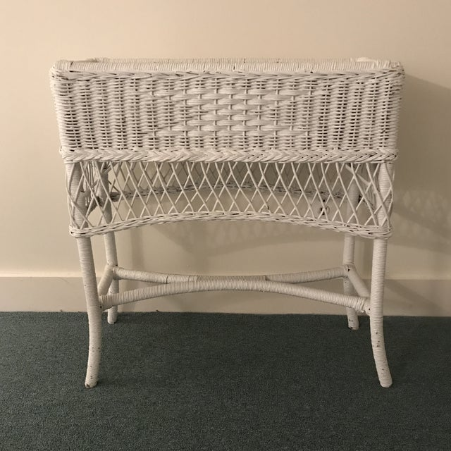 Vintage white wicker plant stand. With galvanized metal insert. Would be perfect on a sun porch. A really interesting and...