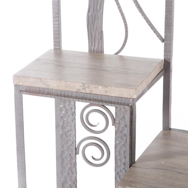 French Hand Hammered Iron Hall Rack with silver finish, marble tops and beveled mirror, ornate roses, and scrolls.