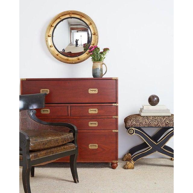Impressive round gilt convex bullseye mirror made in the English Regency or Georgian period style. 20th century...