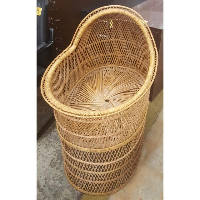 This is a beautiful baby bassinet made of rattan. It is light weight but very sturdy.
