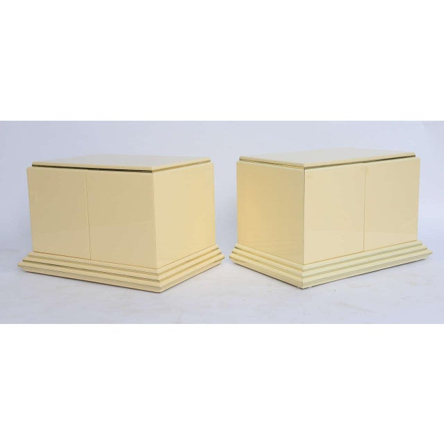 Stunning Moderne Rougier cabinets in original creamy color lacquer finish. Wonderfully streamlined with a stepped base...