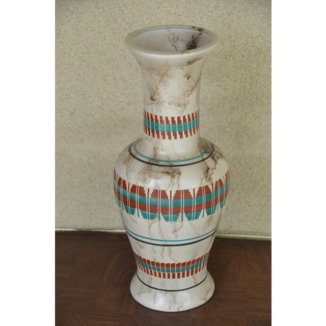(PRICE IS NEGOTIABLE. FEEL FREE TO MAKE REASONABLE OFFERS.) This is a Navajo horsehair pottery vase with some colored...