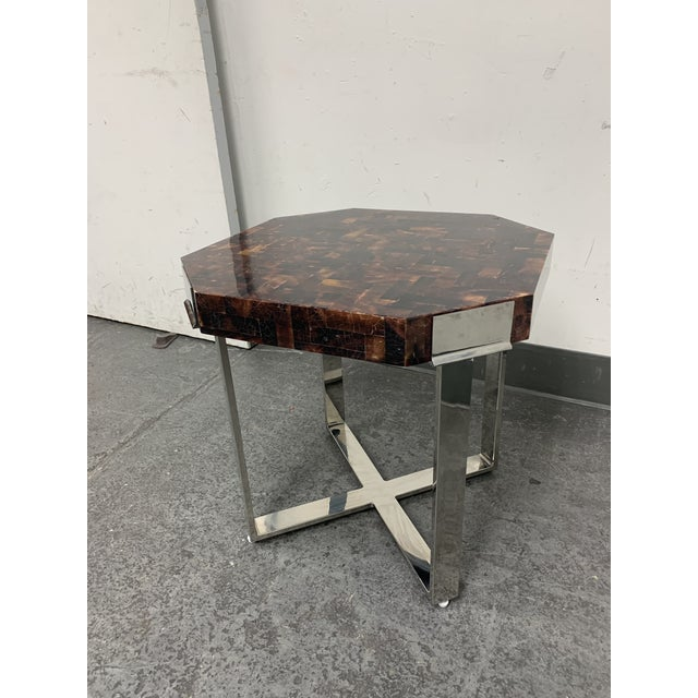 Design Plus Gallery presents a Palacek Shell + Chrome Side Table. Beautiful burgundy and and amber shell is tessellated in...