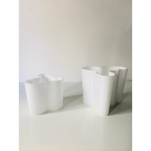"Alvar AALTO (1898 - 1976) A set of two White ""Savoy"" thick glass vase designed by Alvar Aalto around 1970. Each signed..."