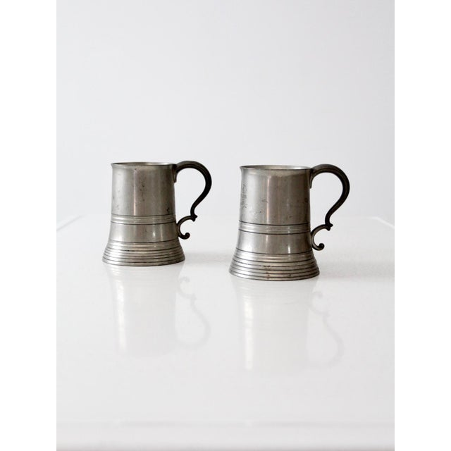 """This is a pair of antique glass bottom pewter tankards. One mug engraved """"JBAA Club Fours July 18th 03."""""""