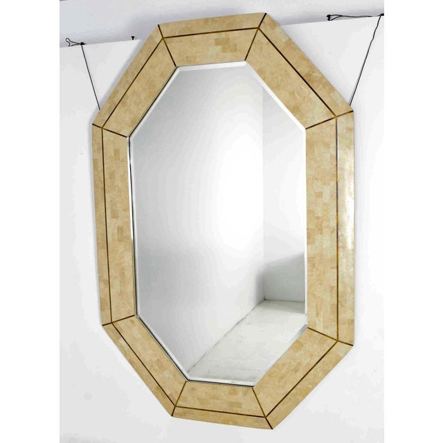 Beautiful tesselated marble mirror by Maitland Smith. Has brass inlay. We have the matching console if desired. They look...