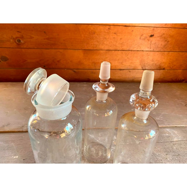 Offering three antique pharmacy bottles, complete with their original stoppers. In excellent condition with no chips, no...