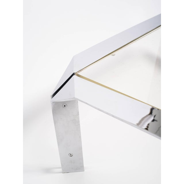 Design Institute of America chrome coffee table with Lucite top.