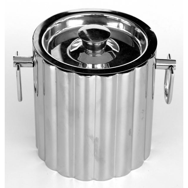 Offered for sale is an elegant and fine quality vintage stainless steel ice bucket created in an Art Deco style. The ice...
