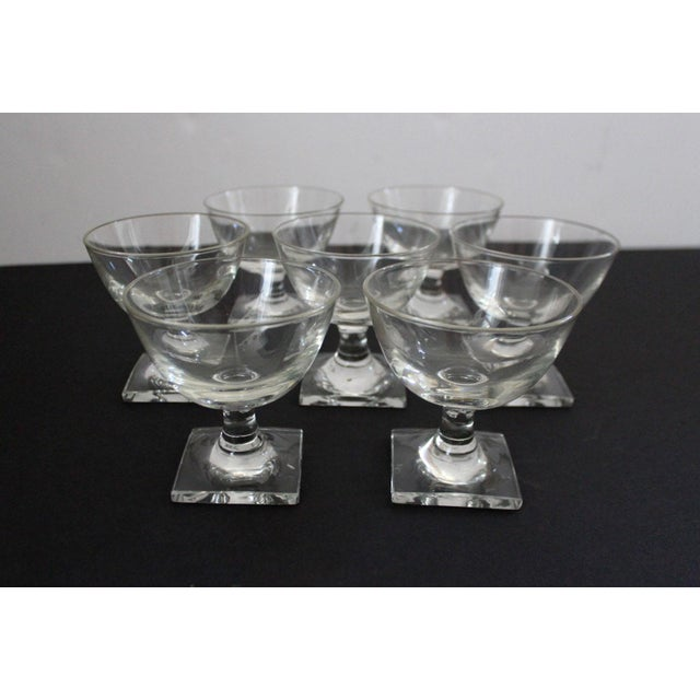 Unique set of short champagne/ sorbet glasses with a hand carved square base. Each work is signed by the artist.