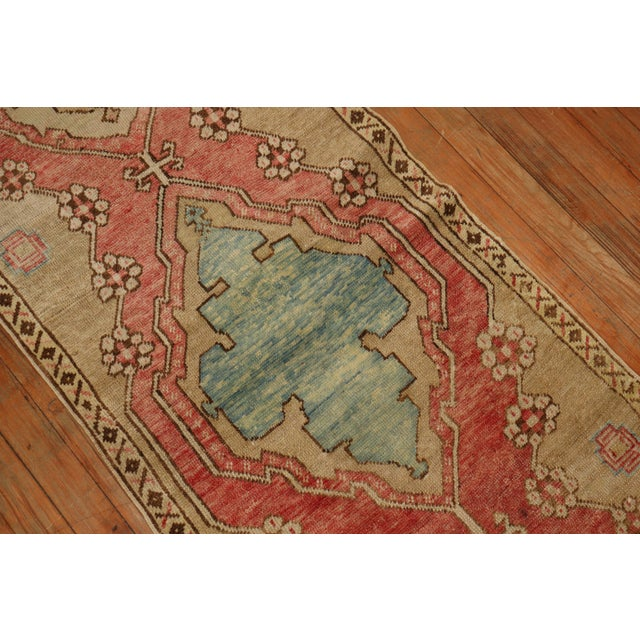 1940's Turkish Oushak Runner with a soft red ground accents in khaki, brown and light blue accents. Hand-knotted, one of a...