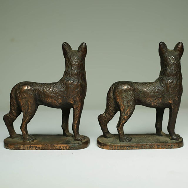 "Beautiful pair of solid bronze bookends of German Shepards. Each are stamped on the base ""1929 Gift House Inc. NYC""."