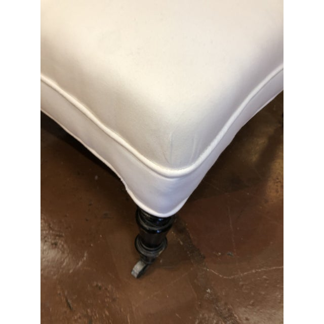 White 19th Century French White Upholstered Ottoman With Hand Carved Dark Wood Legs on Wheels For Sale - Image 8 of 9