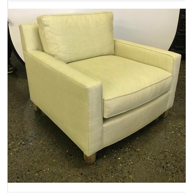 Midcentury style lounge chair has a deep comfortable seat and a wonderful modern aesthetic. Upholstery is pale yellow....