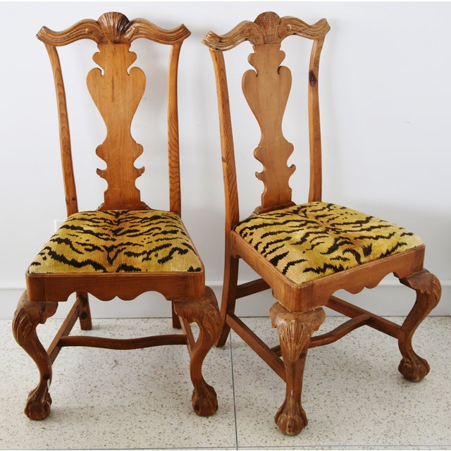 Pair of hand-carved side chairs with ornate back splats, cabriolet legs and claw-and-ball feet. Newly upholstered in new...