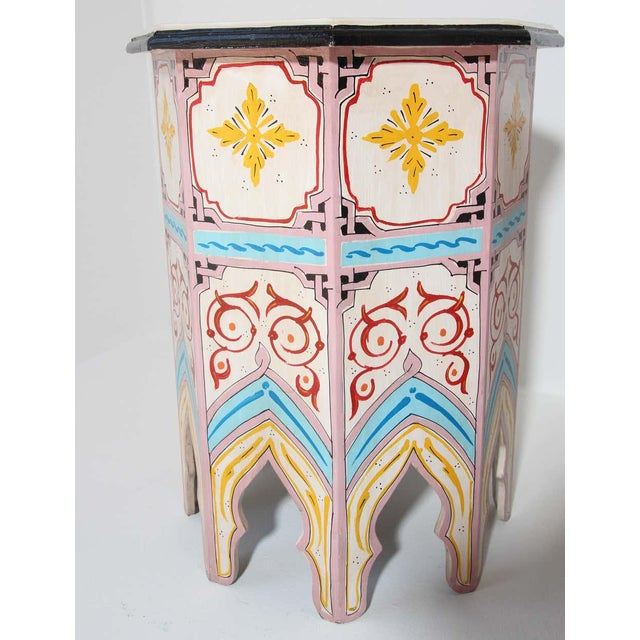 Pair of Moroccan handcrafted and ivory color hand painted tabourets or side tables. Octagonal shape pedestal tables with...