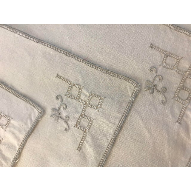This is a lovely set of hand embroidered linen napkins in an off white color cotton and ecru colored stitching. This set...