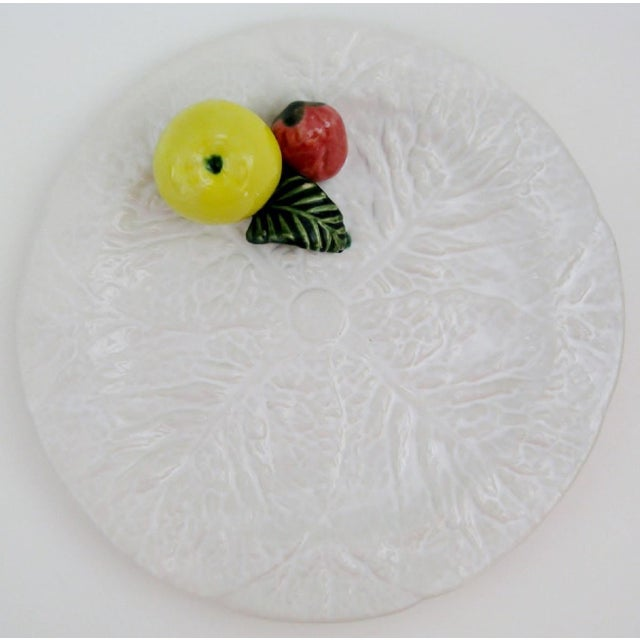 Vintage Portuguese trompe l'oeil porcelain cabbage leaf plate in white glaze with applied red strawberry, yellow apple and...
