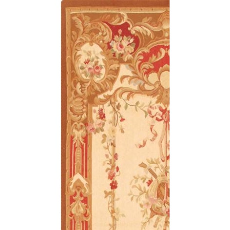 A rich floral tapestry rug of color with ornate blooms and warm border are knotted of 100% silk & wool for soft, springy...
