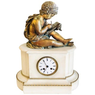 19th Century Figural School Boy Bronze Sitting Atop a Marble Mantle Clock Base For Sale