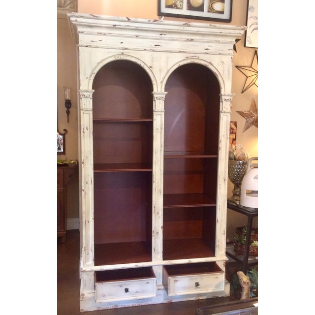 This vintage peice is a really well built traditional European style bookshelf. Two of the shleves have glass inserts. It...