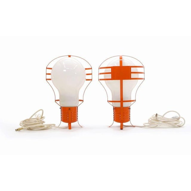Striking pair of 1960s Italian oversized light bulb lamps. These can stand on end on their side or can be hung by the...