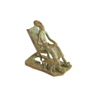 Vintage African Oxidized Copper Seated Man With Dog For Sale