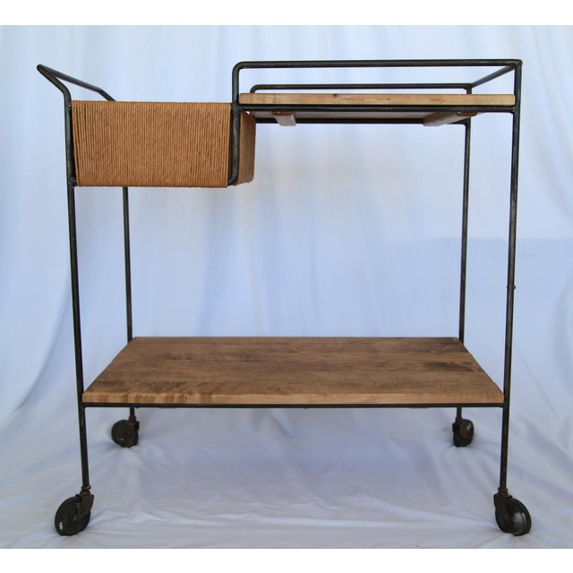 Mid-century modern bar cart attributed to Arthur Umanoff. Features multi-material construction, including wood, iron, and...