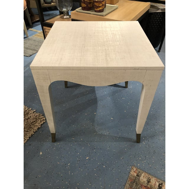 The Clayton side table beautifully showcases how nubby & organic raffia fabric is applied to a side table. This table is...