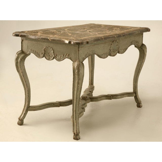 Magnificent original Italian restored paint center table with a great faux marble top. The details on this table are...