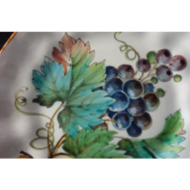 "Lavishly painted fruit on medium size plates: cherries, grapes, 2 of lemons. Gold rim, gently fluted, 9"" diameter. Signed..."