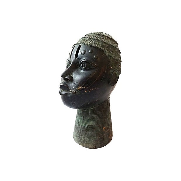 1960s cast bronze head of King Oba of Benin. Made to glorify the great king, or Oba, who is considered to have divine...
