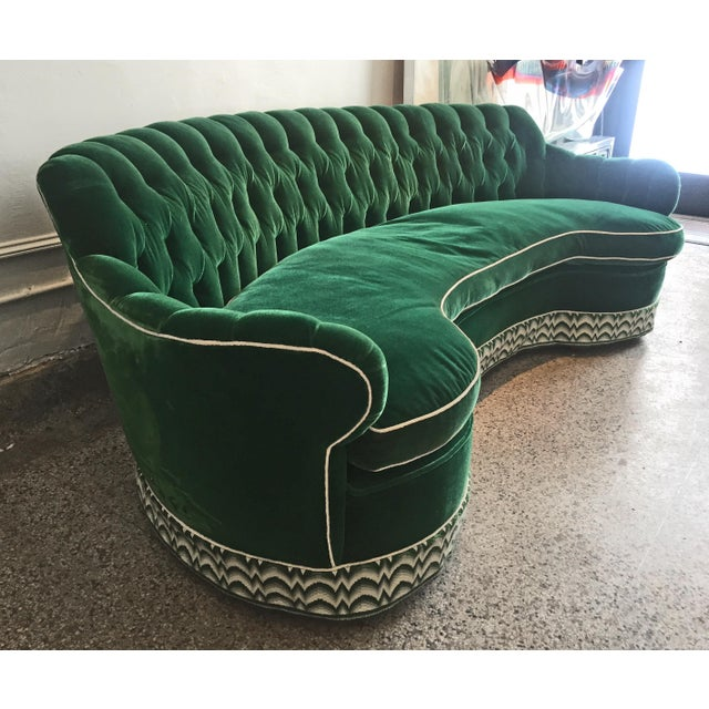 Creme de menthe,..except so much better. This stunning emerald green curved and tufted sofa epitomizes the glamorous...
