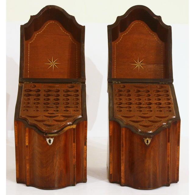 A fine pair of English mahogany serpentine inlaid slant top knife boxes with exterior Satinwood paterae and herringbone...
